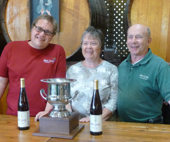 August Deimel, left, with the Governor's Cup and his bosses, Judy and Len Wiltberger. Photo courtesy Keuka Spring Vineyards