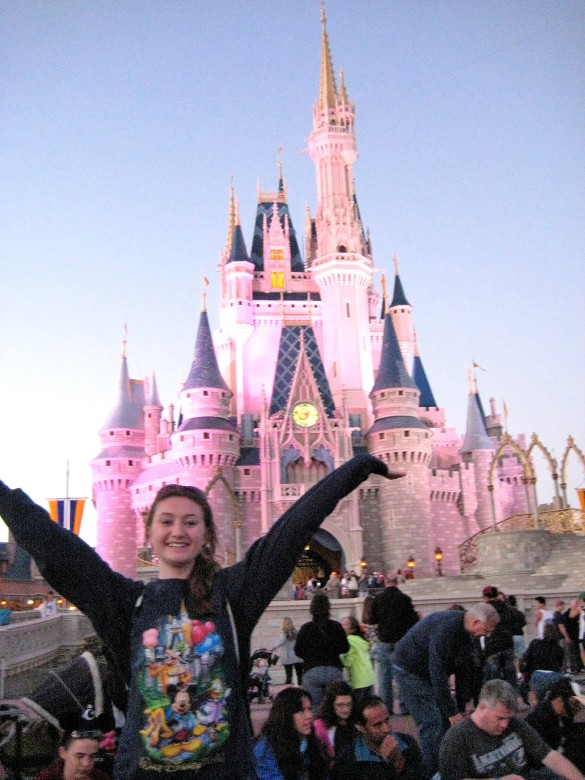 Author Kathryn Mellett in front of Cinderella's Castle, in Disney World