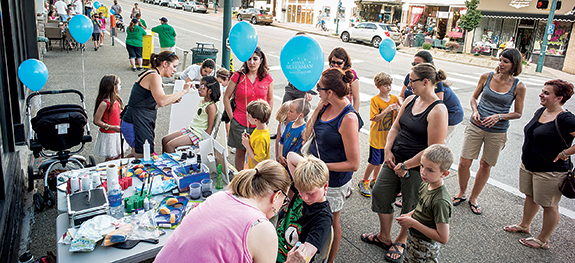 During First Friday hundreds of people line the sidewalks of Washington Road, watching live bands, getting their faces painted or participating in family friendly activities.