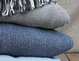 Warm wool clothing on a table