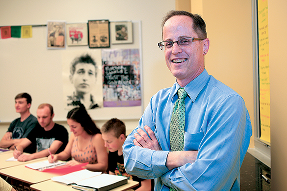 "History and government teacher Pete DiNardo has a bright, larger classroom in the B building, the historic building constructed in 1930 along Cochran Road. ""I'm convinced by the statement 'place matters,'"" he says. ""When you see kids in the parts of the building like the cafeteria, like all those practice rooms, and they've got now a new quality space to be, they deserve to be surrounded by vibrant joy there."""