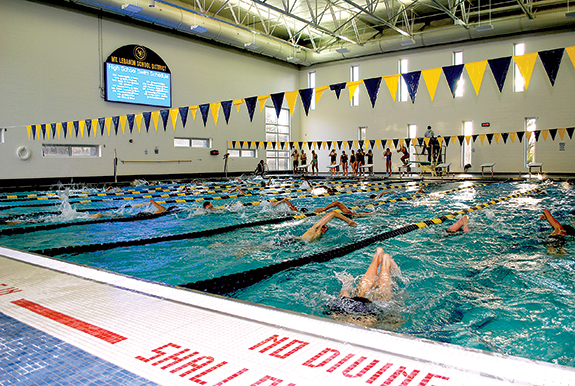 The athletic building is all new construction, built on a former practice field and the tennis courts (which will be replaced elsewhere on campus later this year or next spring). It includes a new 25-yard, 8-lane competitive pool flooded with natural light, and a digital scoreboard. It has locker rooms and areas for fitness conditioning, wrestling and sports administration, along with space for the trainers to treat athletes.