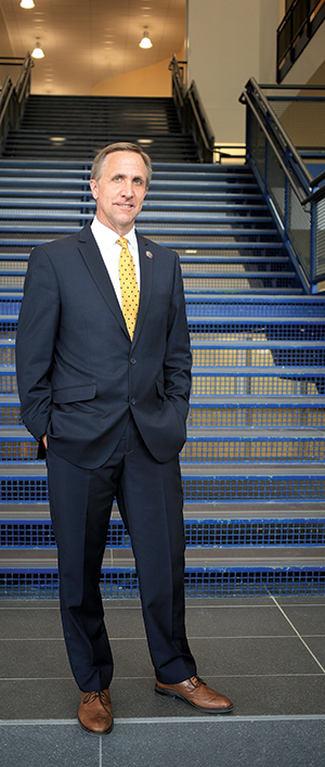 Superintendent Tim Steinhauer at the foot of the grand staircase at the new Horsman Drive main entry.