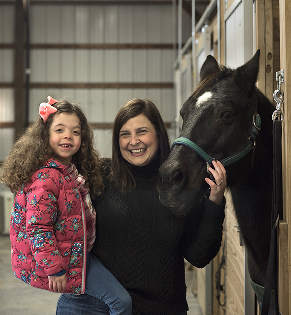Lisa Wahl and her daughter Hannah, age 6, at Horses with Hope in Bethel Park.