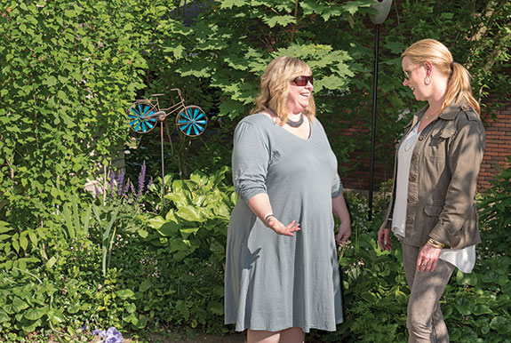 Community Relations Board Chair Lisa Borelli Dorn, a lawyer, right, and her fellow board members are prepared to help neighbors resolve problems through free, confidential mediations. But Borrelli Dorn advocates always trying to speak with a neighbor in person about an issue before seeking professional help or calling the police. She is pictured with her friend and neighbor Annie Laurie Faust.