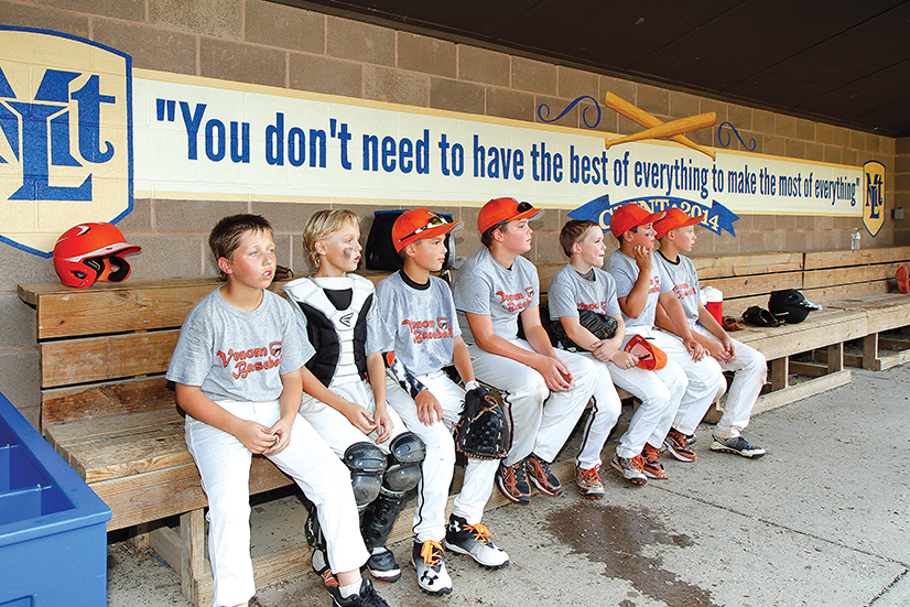 Murals with inspirational quotes are part of the $60,000 worth of improvements that The Clint Seymour Play Ball Foundation paid for Clint Seymour Field on Cedar Boulevard. The field, formerly Wildcat Field, was renamed in the former Lebo baseball player's honor earlier this year, after his tragic death in 2014. Other improvements to the field include a new electronic scoreboard, new safety screens and repairs to the bullpen. /Photo: Julie O'Hara