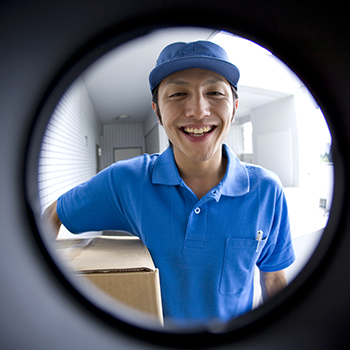 Delivery person seen through peep window