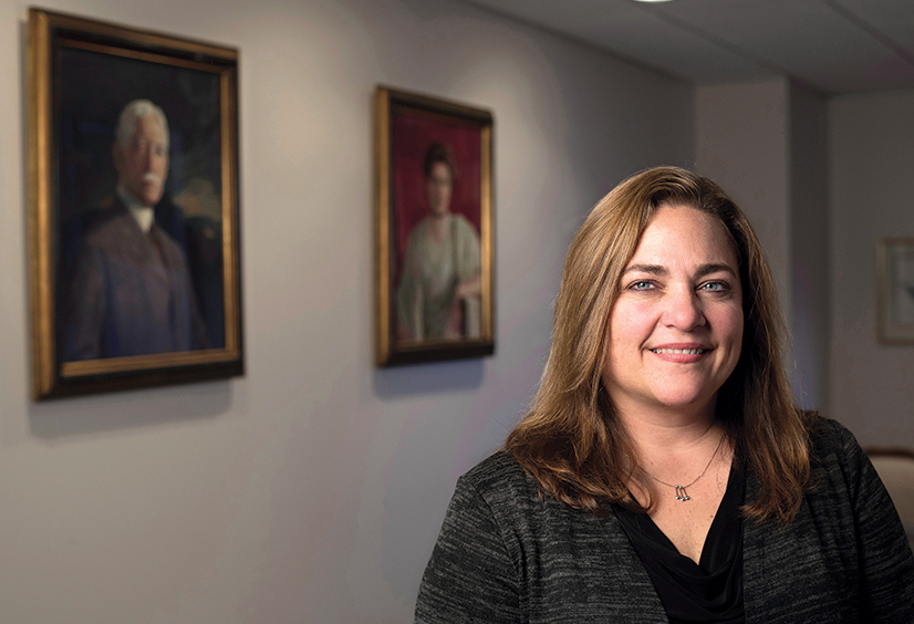 Diane Bucco - President of the Buhl Foundation - in the board room of the Buhl Foundation with portraits of Henery Buhl Jr. and his wife Louise C Buhl.