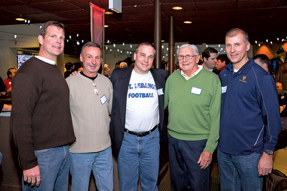 Surrounding Jeff Linkowski, center, are former Mt. Lebanon football coaches, from left, Chris Haering, Paul Kmec, Art Walker and current coach Mike Melnyk. Linkowski, who wrote Mt. Lebanon Football: A Tradition of Excellence as a fundraiser for the Blue Devil Club, organized a reunion at Bados that drew Lebo players and coaches from the 1950s to the present.