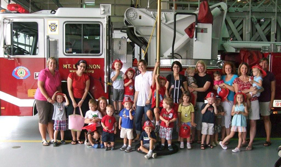 MLJWC members and their kids at the Mt. Lebanon fire station getting safety tips.
