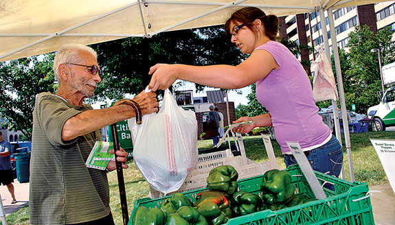 The Partnership plans many annual activities to attract people to Mt. Lebanon and its main street, Washington Road. Clockwise from left: The Uptown Farmers Market makes for fresh and friendly shopping every May through October. From produce to meat to herbs and bread, you can eat local by shopping there