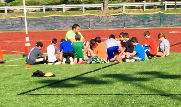 A counselor reviews the turf rules with the participants in the Rec Department's All Sports camp