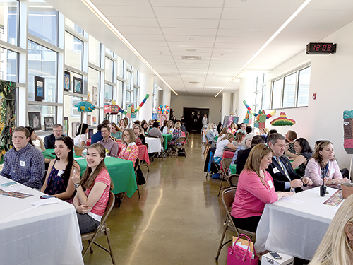 "In the new building, spaces aren't single purpose. The ""Skywalk,"" is the bridge across Horsman Drive that connects the academic buildings with the athletic facilities. But since it opened, it has beome a gathering place, hosting a PTA luncheon and the prom fashion show among other events."