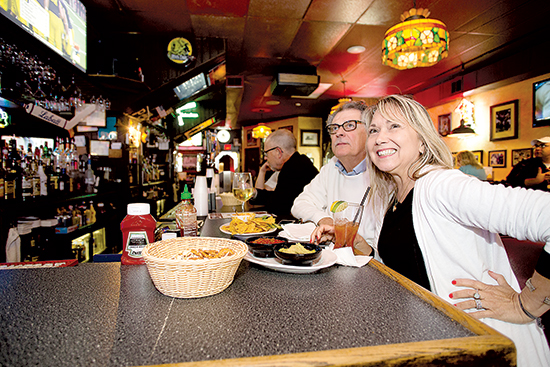Rhonda and Calvin Rockwell watch the Steelers.
