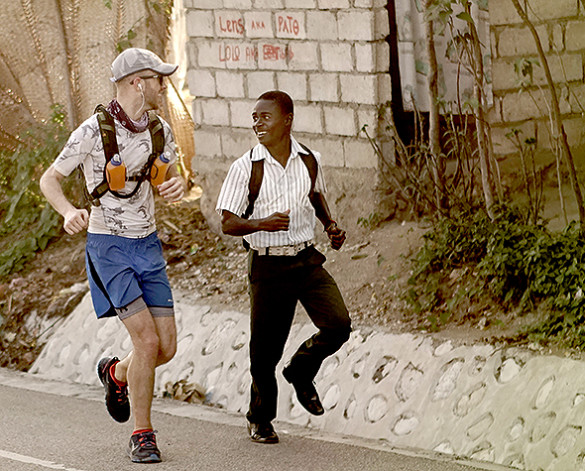 Owen Mattison running with a local in the 2015 Haiti Run. Photo by Taylor Rees