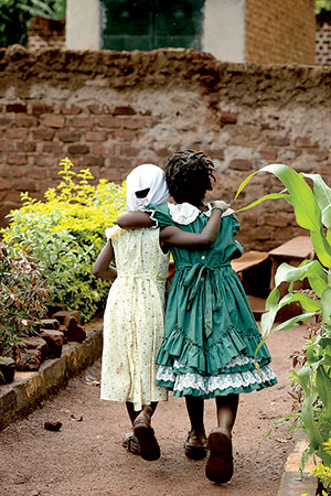 Bright Kids Uganda have four main rights: to live; to grow; to develop as a person through education and to participate in planning their future. See photographer Martha Rial's photos of these and other people affected by poverty war and gender violence at Gallery 937, downtown Pittsburgh, beginning September 27.