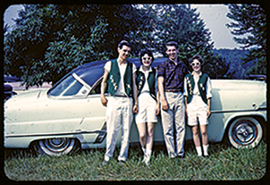 """Class of '59 graduates Dave Royer, Kathleen Allen, Don Stocker and Annette Galluze donned vests in their class color before driving around town honking horns before the last day of school, a """"Senior Day"""" tradition."""