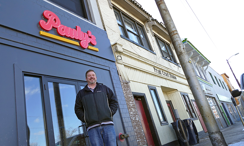 Paul Yelenovsky stands outside his new restaurant, Pauly's, on West Liberty Avenue.