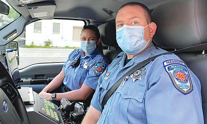 Two paramedics in an ambulance.