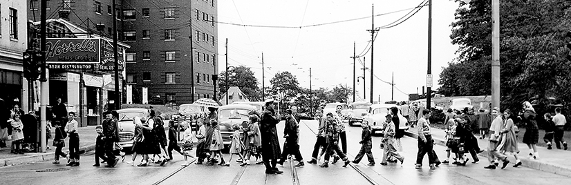 Teacher guiding children across Washington Road in 1952.