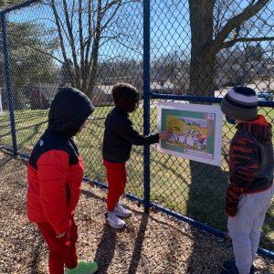 Children view the StoryWalk at Jefferson Elementary