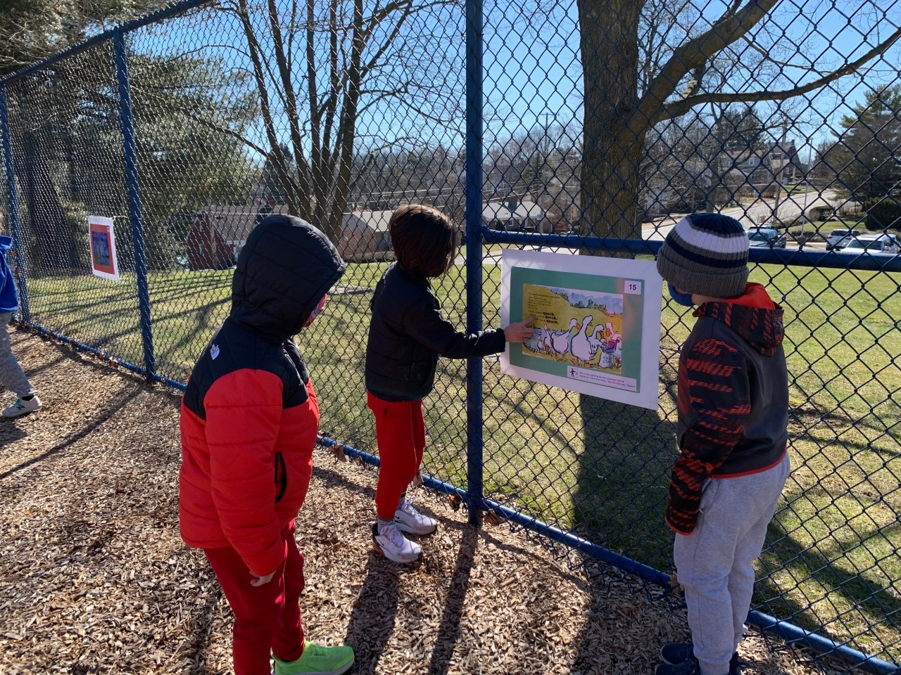Children view the StoryWalk at Jefferson Elementary