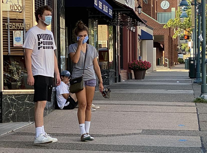 Couple wearing masks on Washington Road