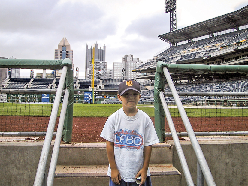 David Bednar as a child standing on the stairs of the entrance of the field at PNC Park in Pittsburgh.