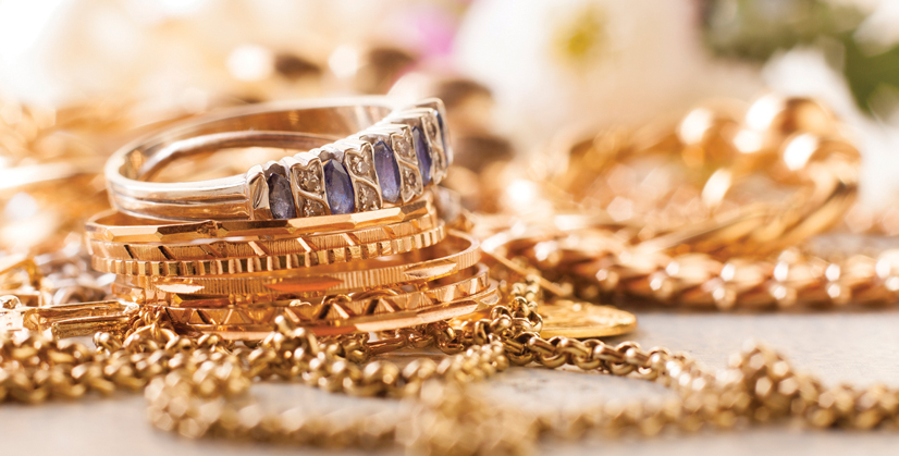 Gold jewelry sitting on a table.