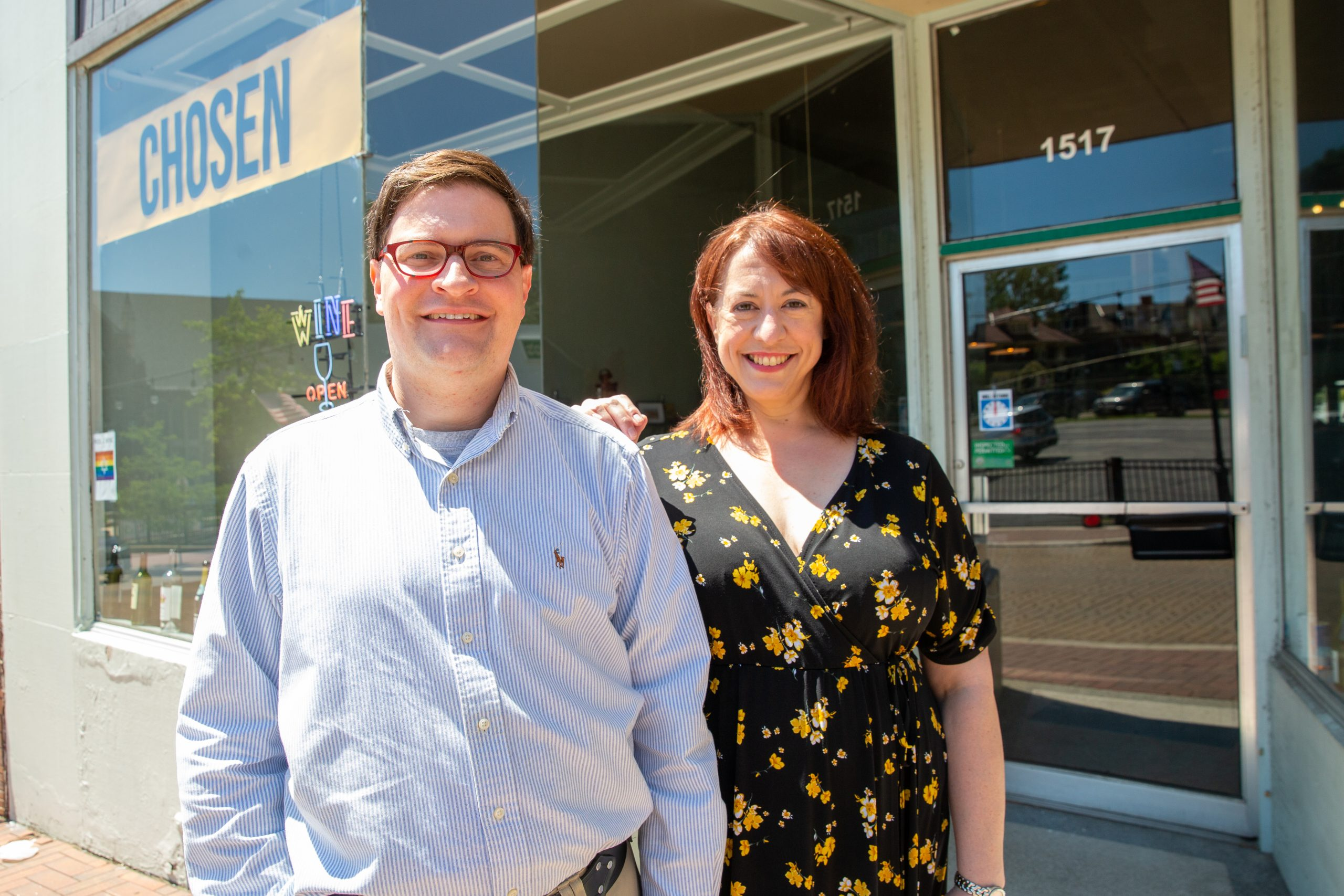 Curt Friehs and Cynthia Craig stand, smiling, outside their storefront.