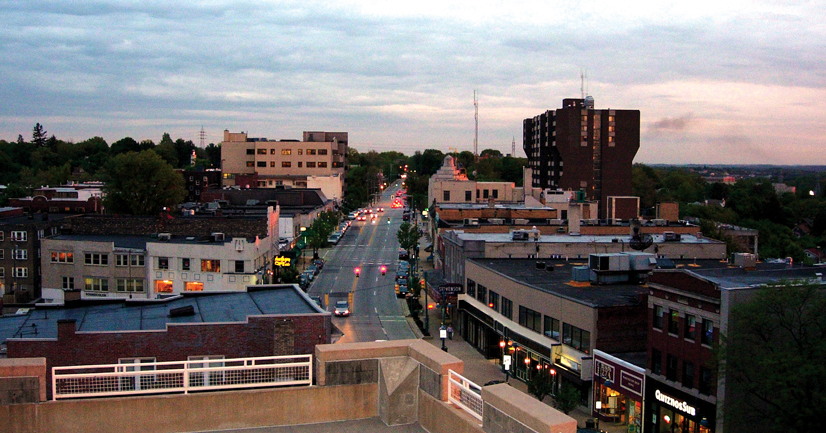 An overhead shot of Washington Road, with buildings and a street, in twilight time of day.